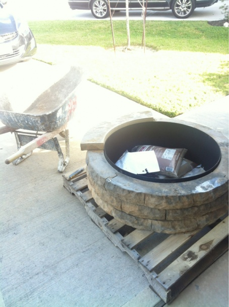 Fire pit over concrete patio-image-1133638973.jpg