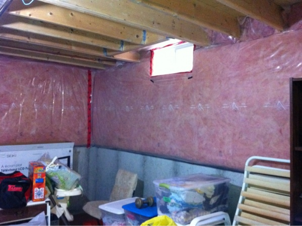 Installing XPS foam panels where existing pink bat insulation.-image-1303414528.jpg