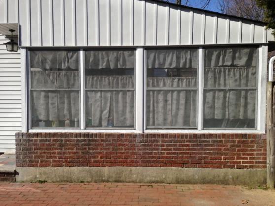 Reframing windows on brick knee wall-image-1822579279.jpg
