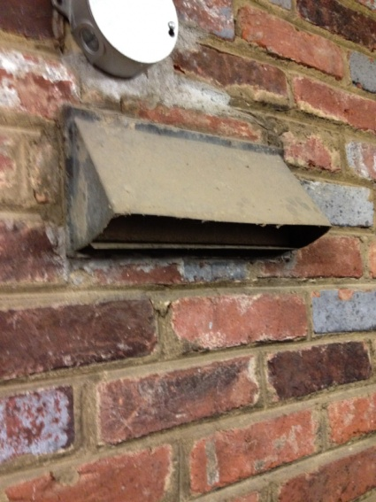 Capping vent in brick wall-image-2056198138.jpg