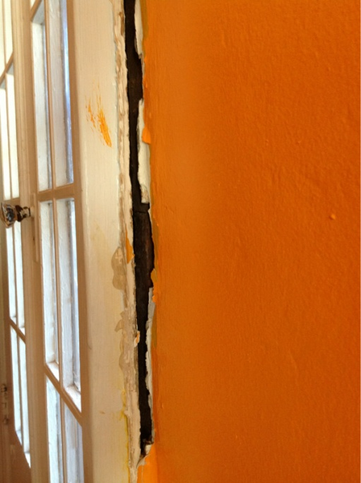 Filling a gap between wall and door frame.-image-2301397992.jpg