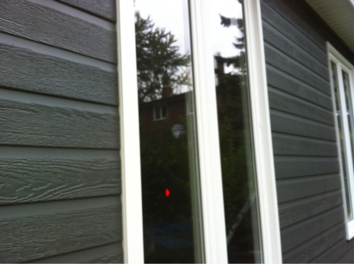 Outdoor light on siding-image-2469443519.jpg