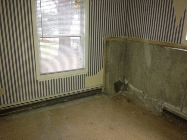 Hydronic baseboard mounted to concrete wall-image-2547983446.jpg