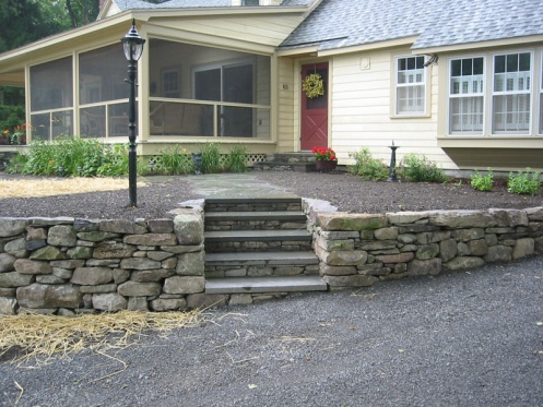 Deck stairs over existing stone retaining wall steps-image-2626218787.jpg