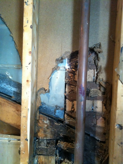 Wall damage in bathroom.-image-2681540809.jpg