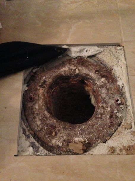 Installing new toilet over old rusted flange-image-3000421832.jpg