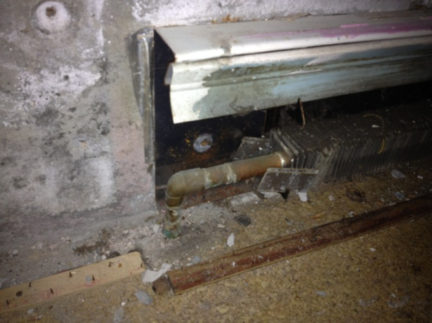 Hydronic baseboard mounted to concrete wall-image-3626191048.jpg