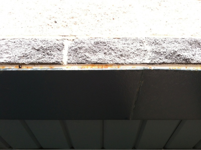 Rust on exterior trim above garage-image-3648700091.jpg
