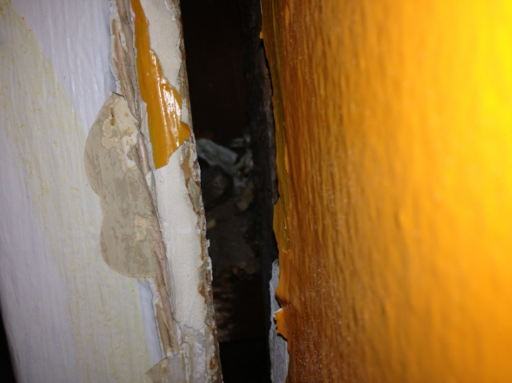 Filling a gap between wall and door frame.-image-4193820731.jpg