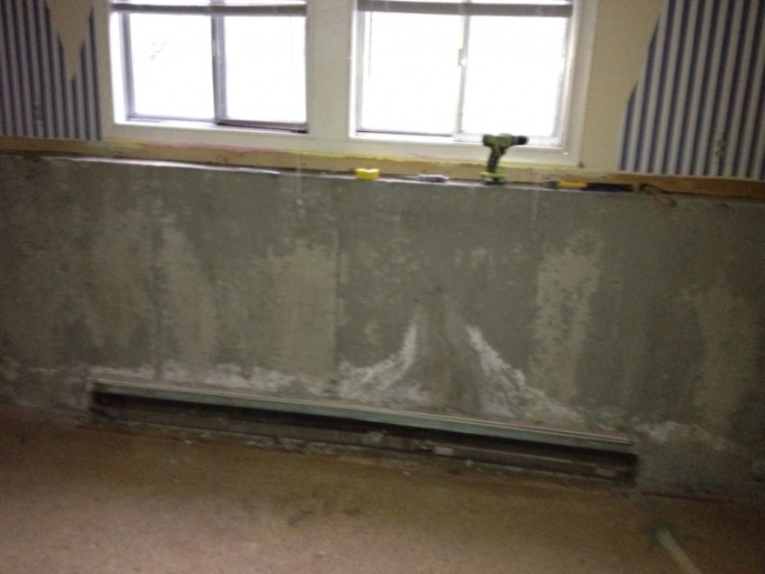 Hydronic baseboard mounted to concrete wall-image-4284982894.jpg