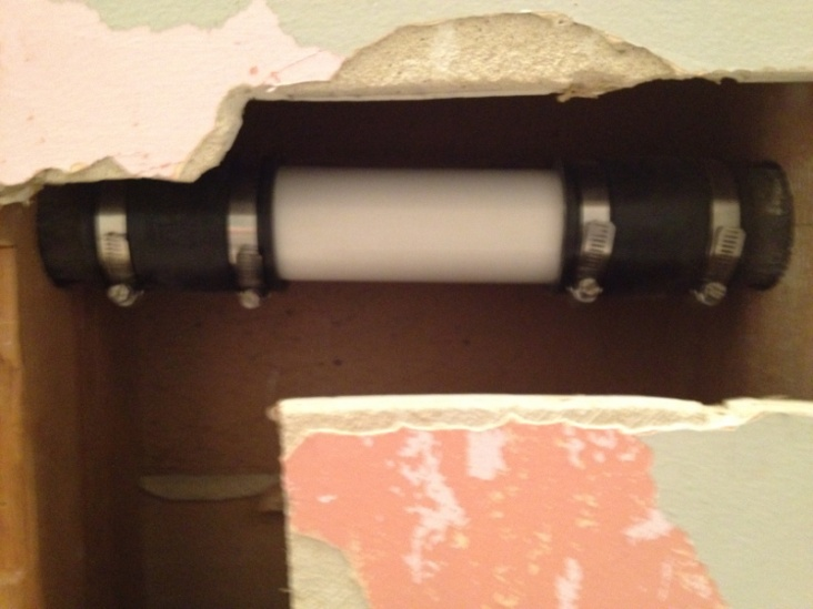 "2"" pipe on above sink in wall rusted out in a spot-image-777584142.jpg"