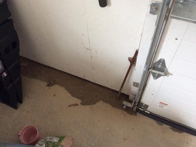 Water Leaking Under Garage Door After Rain Storms