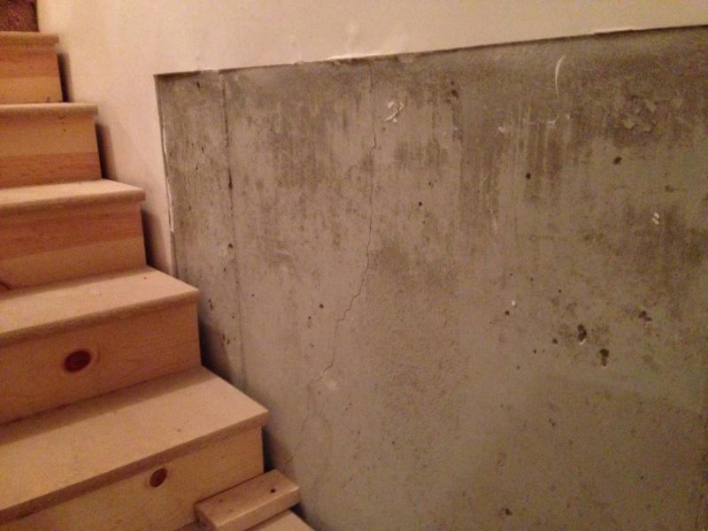 Sheetrock On Concrete Wall Next To Stairs Building