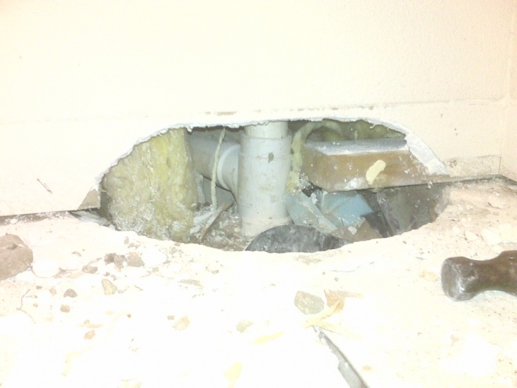 Pulled up carpet to put in wood flooring and found 2' plumbing hole in slab.-img00146.jpg