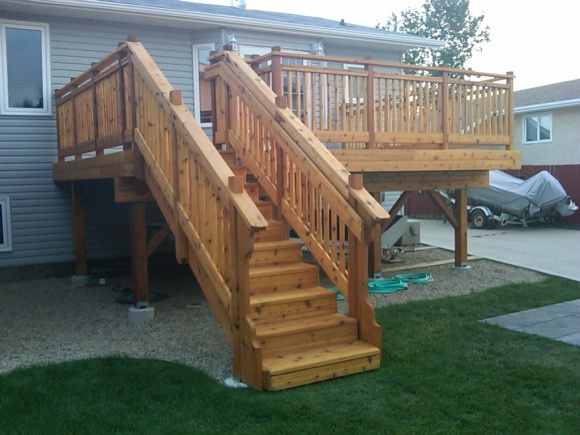 Cedar vs pressure treated building construction for Cost of composite decking vs pressure treated