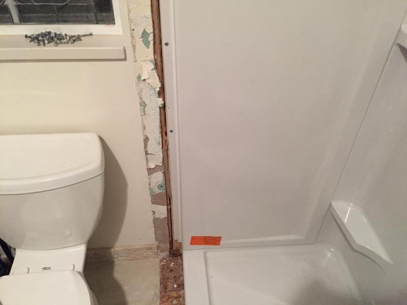 overlapping drywall onto a fiberglass shower