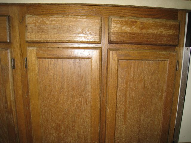 restoring wood cabinets in kitchen kitchen cabinets paint or restain painting diy 25537