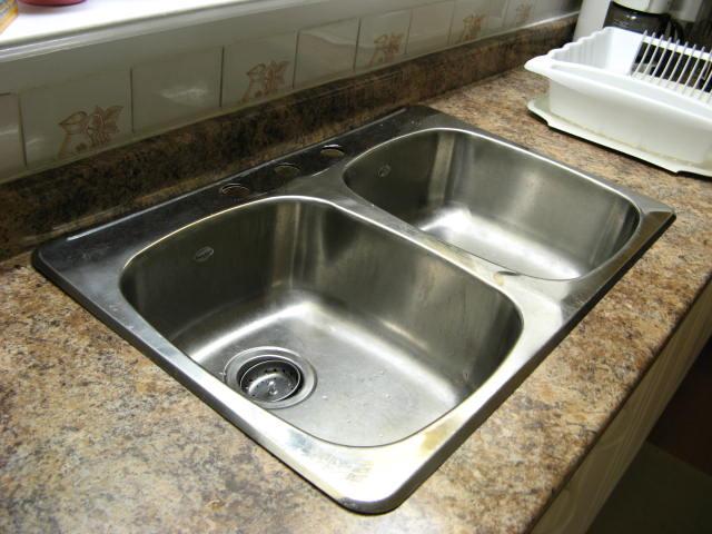 Warped Countertop at Kitchen Faucet-img_0205.jpg