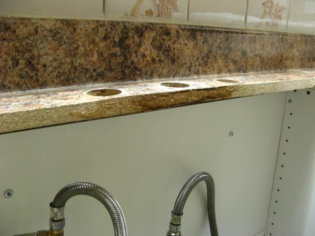 Warped Countertop at Kitchen Faucet-img_0206.jpg