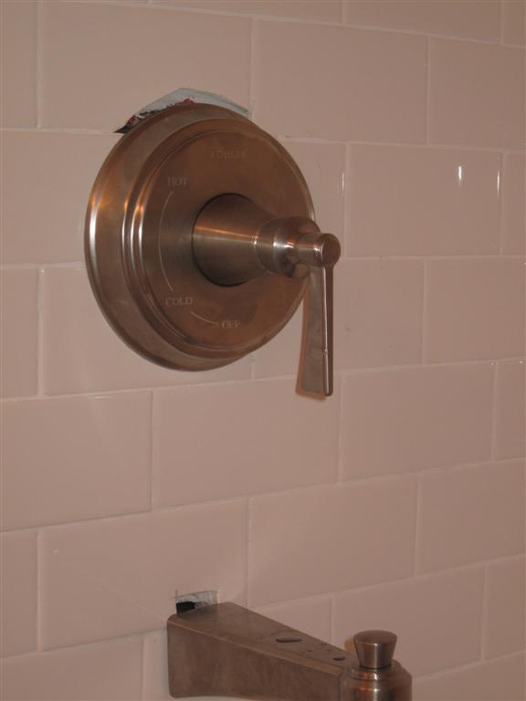 Need to replace two tiles on brand new wall-img_0218-large-.jpg