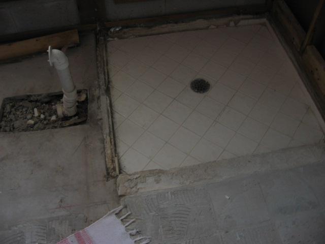 Flooring and Carpeting: elevated concrete floor in a bathroom