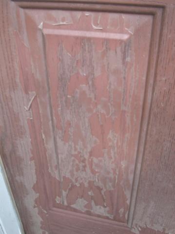 Peeling coating on exterior door-img_0682.jpg