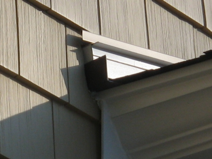 Siding where roof meets wall-img_1270.jpg