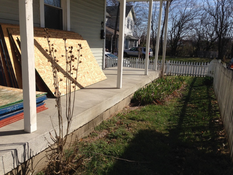 Concrete porch poured over wood siding-img_1408.jpg