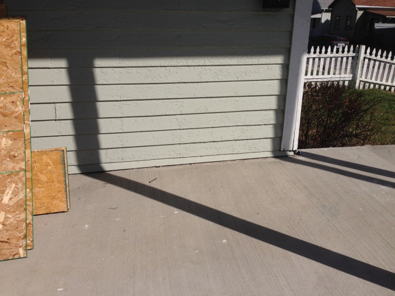 Concrete porch poured over wood siding-img_1409.jpg