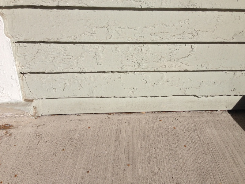 Concrete porch poured over wood siding-img_1411.jpg