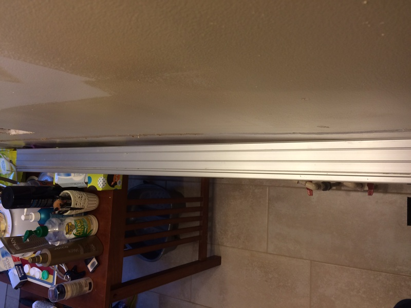Install base cabinets on uneven wall-img_1468.jpg