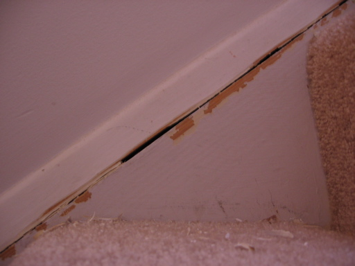 baseboard trim gaps on stairs-img_1760.jpg