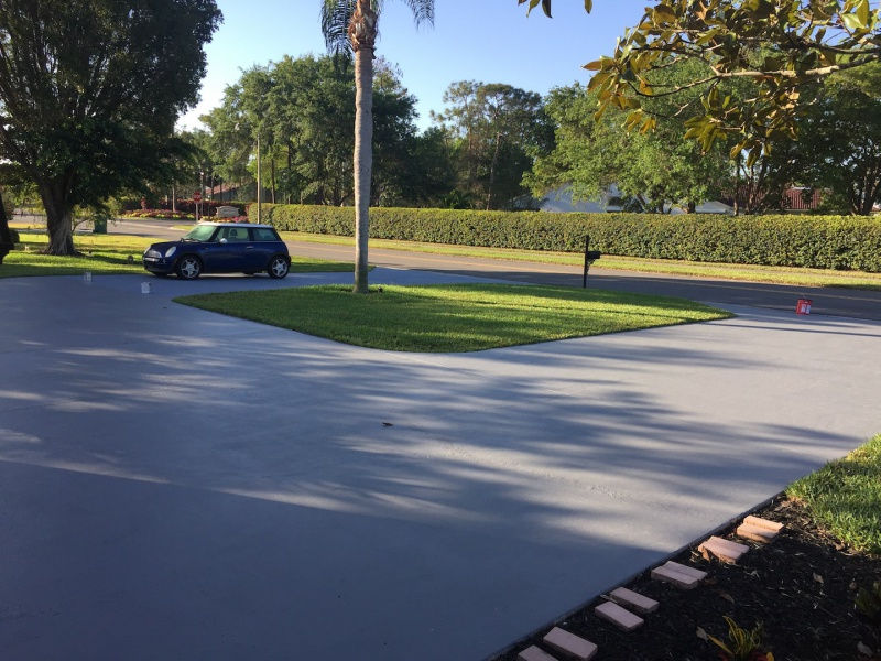 Concrete driveway caulk removal from fresh repair for Removing concrete driveway