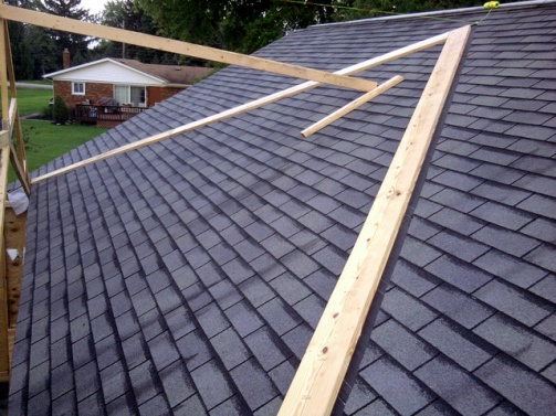 Tying in new garage roof to old garage roof roofing for Building onto your existing home