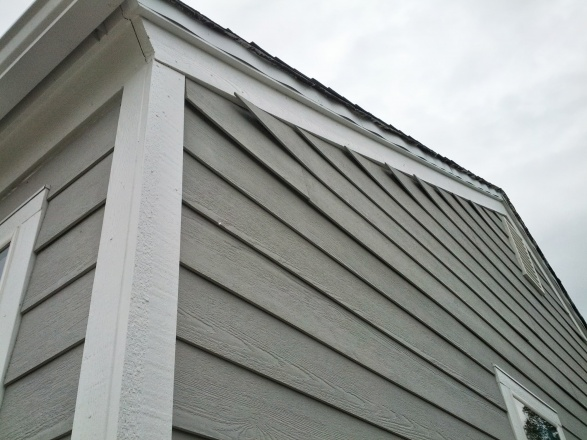 Fiber Cement Siding Curling At Gable Edge Building