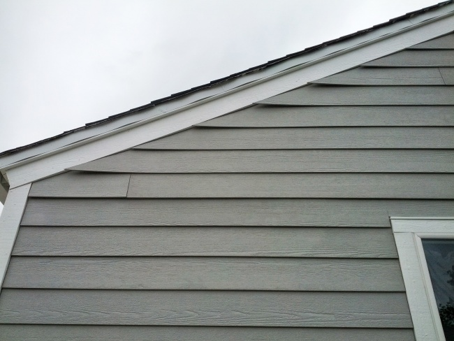 fiber cement siding curling at gable edge.-img_20130603_122543.jpg