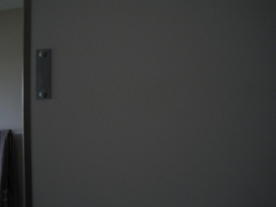 Remove the stainless steel strip around the mirror on my bathroom mirror-img_2064.jpg