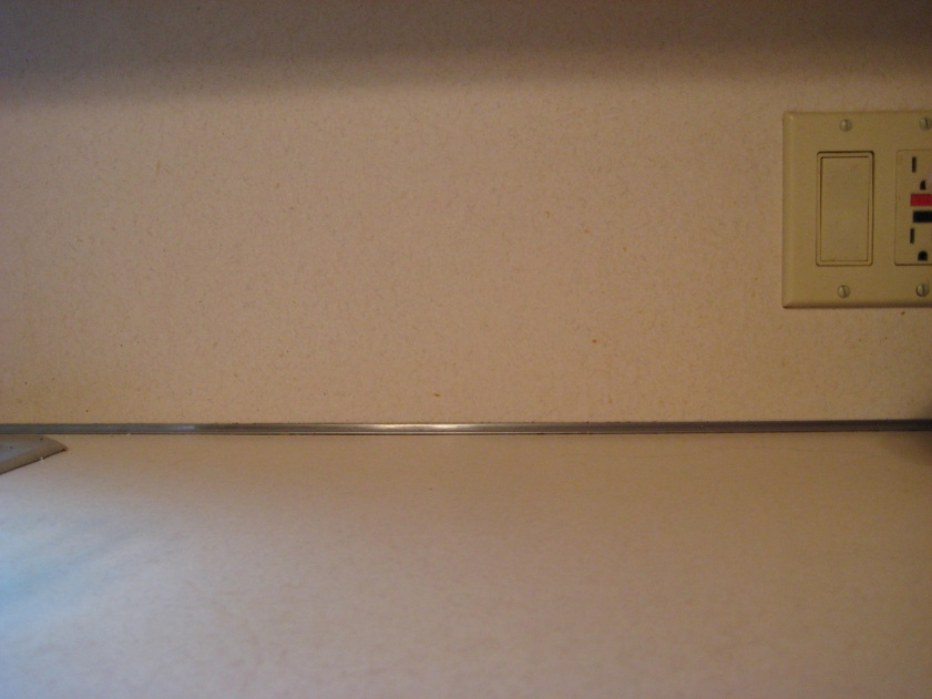 Tiling backsplash over laminate????-img_2525.jpg
