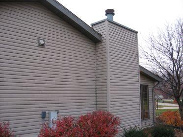 Vinyl Sided Chimney On Side Of House Rotting Osb