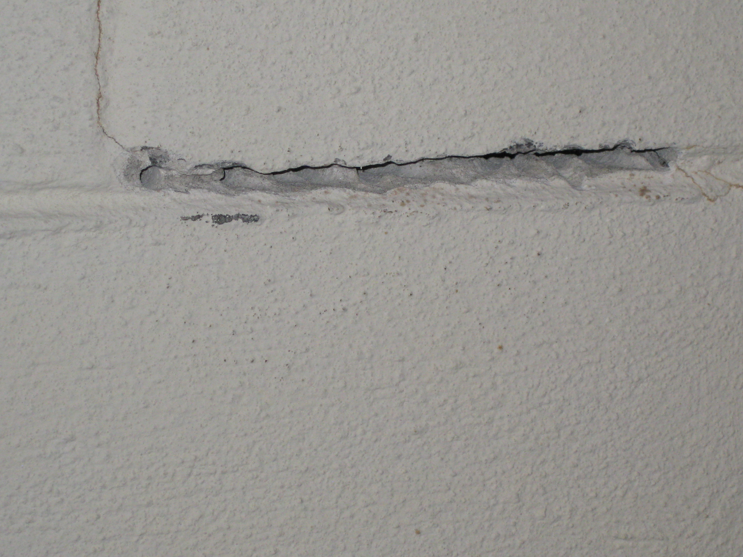 How do I fix mortar that is cracked on basement walls-img_3640.jpg
