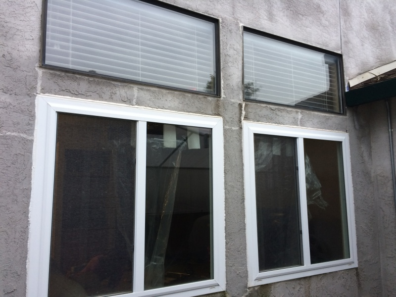 Hole in stucco and two leaking windows-img_4162.jpg