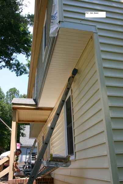Vinyl Siding On The Overhang Area Building