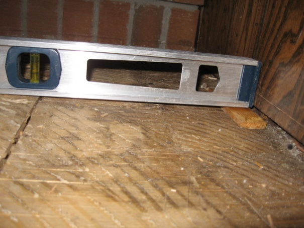Level a subfloor with sagging joist for hardwood floor-img_4498.jpg