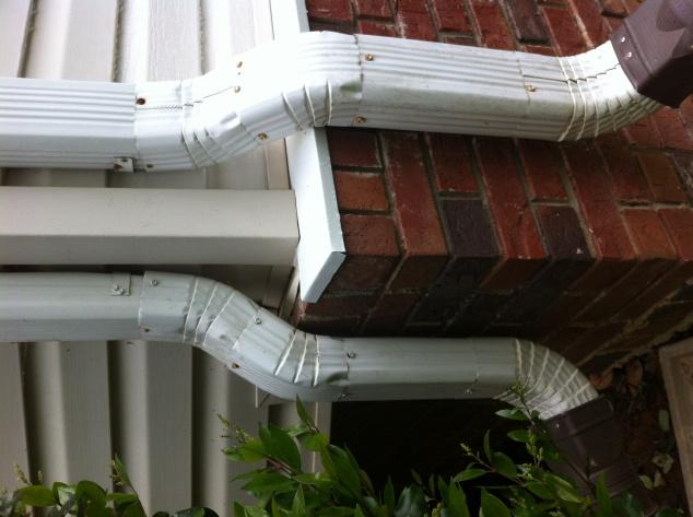 Repaired Brick Wall Meets Vinyl Siding Leak Building