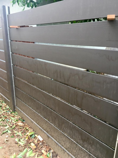 Water marks on stained fence-img_4854_1494392602585.jpg