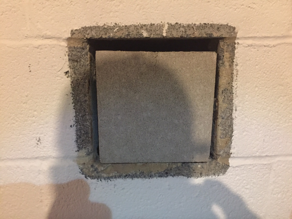 sealing an ash pit in basement for finishing concrete stone