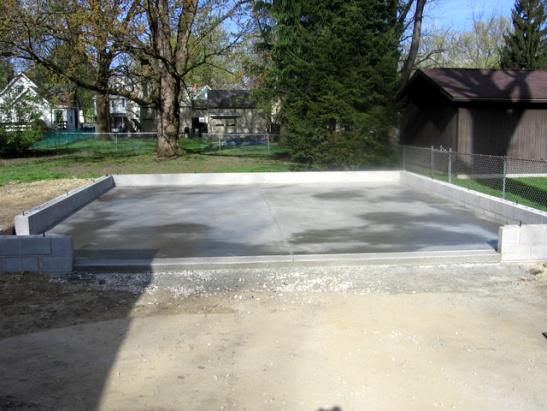 Framing detached garage on sloped pad building for Building a detached garage on a slope