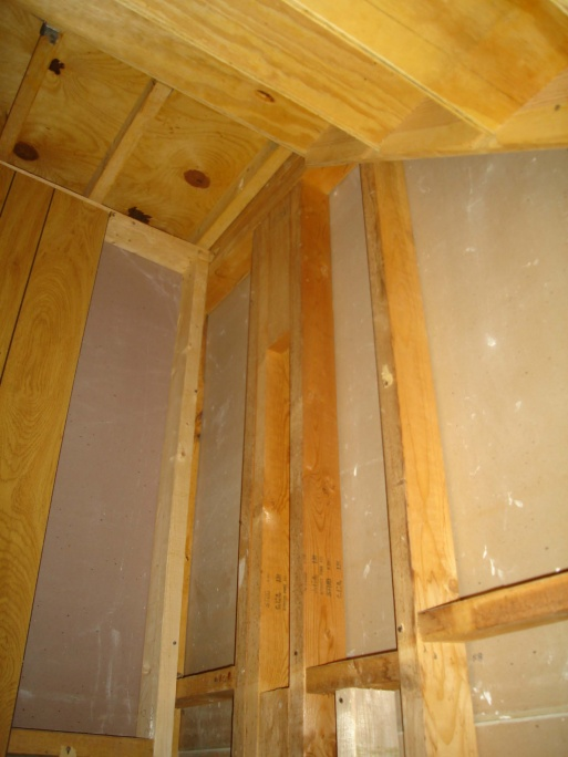 load bearing? I want to put in a pocket door under stairs-inside_stairs3.jpg