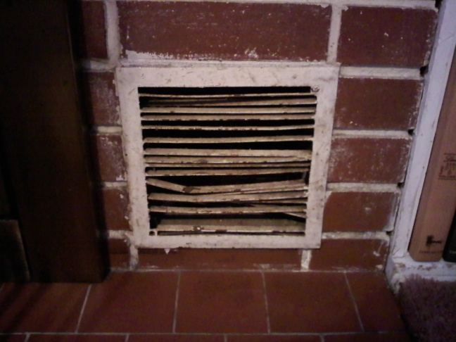 Painting mortar on brick fireplace-intake-cover.jpg