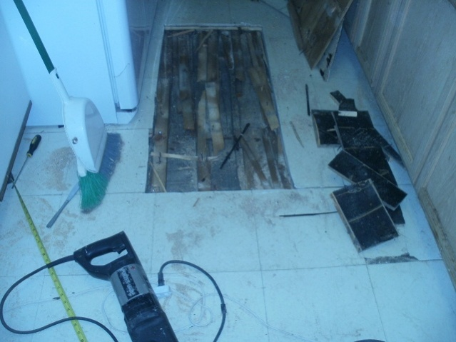 Layers under my kitchen floor-kitchen-shim-layer.jpg